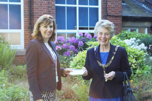 Head Teacher, Sarah Burns receiving the cheque from Mayor Merry